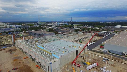 AVG Bau Goch kreeg opdracht voor volledige infrastructuur industrieterrein Keulen, Köln, inclusief grote logistieke hal en kantoren. Industriestraße Köln.