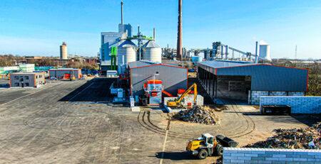 Samenwerking tussen AVG en Solvay resulteert in complete biomassacentrale voor afvalhout met opwerking in Rheinberg - Kooperation zwischen AVG und Solvay resultiert in komplettem Biomassekraftwerk für Altholz mit Aufbereitung in Rheinberg
